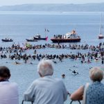Climate Protesters Rally on the Streets and Sea Amid G7 Summit